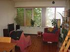 huiskamer met het raam op het westen